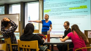 Political Science instructor Janet Campbell discussing Measure 97 with students in the Town & Gown room on Wednesday.