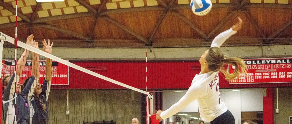 Dannell Woodcock leaping for a kill shot against Clark College on Wednesday Oct. 12 in the three set loss.